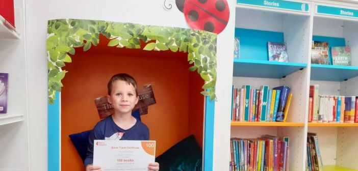 Reuben, six, is named fastest finisher of Book Track Award at Ottery Library