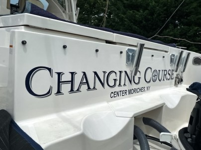 changinf course letter wrapped boat