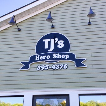 TJ's Hero Shop carved sign