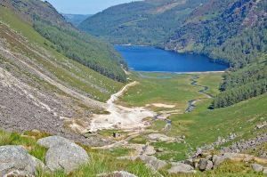 Descending towards the Miner's Village and the Upper Lake of Glendalough while walking the Spinc Loop during our Hiker's Tour of Ireland