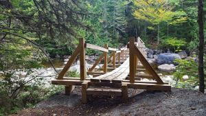 Bridge over the Opalescent River on the way to Allen Mountain