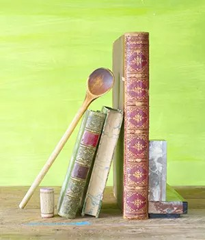 cookbooks and a wooden spoon