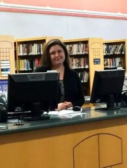 Friendly librarian at a desk