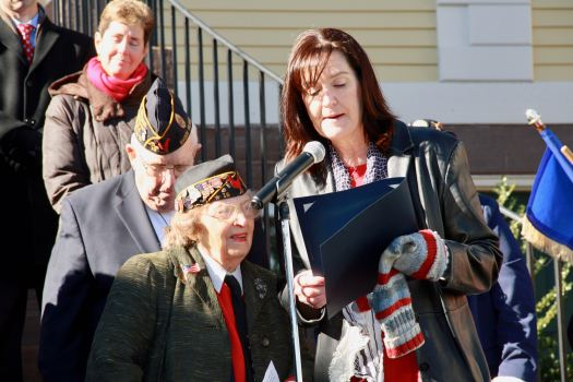 """Town Council President Sue Cienki reads a proclamation declaring Nov. 11, 2017, """"Lucy Amat Day."""" Amat has served as chaplain of the American Legion Post 15 since 1991 and has NEVER missed a parade in those years."""