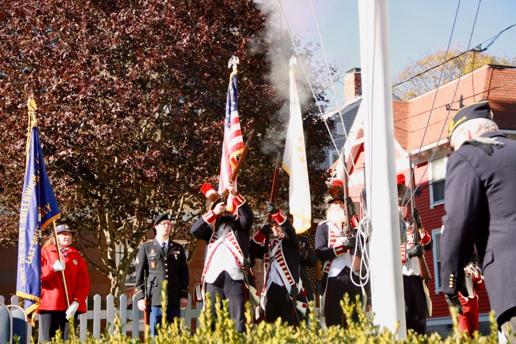 Kentish Guard fire in front of Town Hall after a wreath is laid at the war memorial there.