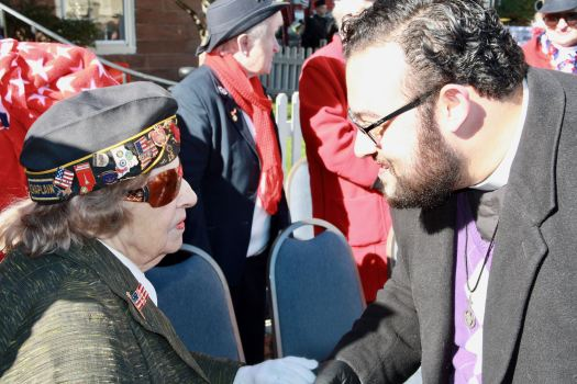 Rev. Dante Tavolaro greets Grand Marshal Lucy Amat at the conclusion of the Veterans Day ceremonies in front of Town Hall.