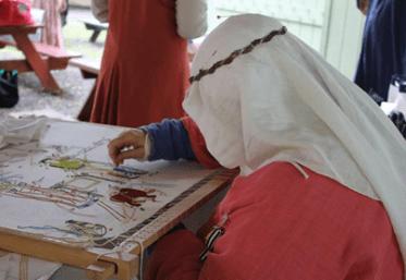 Lady Elizabet Marshall, coordinator of the Fiber Arts village, demonstrating her embroidery work.