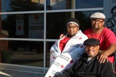 Shelter residents Latonya Myers, son Ronald and husband Ronald Sr.