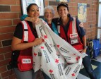 Shelter resident Lois ward is flanked by Red Cross volunteers Tanya Medley and Ann Soeder