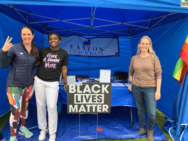 Devon Wible, Lila Estime and Tracy Carlucci greet voters in the Easton Democrats' tent at the May 4 referendum. — Jane Paley Photo