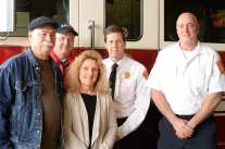 From left, Kurt Steiger, firefighter David McRae, Kathy Steiger, chief Kevin Partridge, and captain Jim Walsh,at the Lothrop Street fire station in Easton , Tuesday, April 17, 2018. (Marc Vasconcellos/The Enterprise)