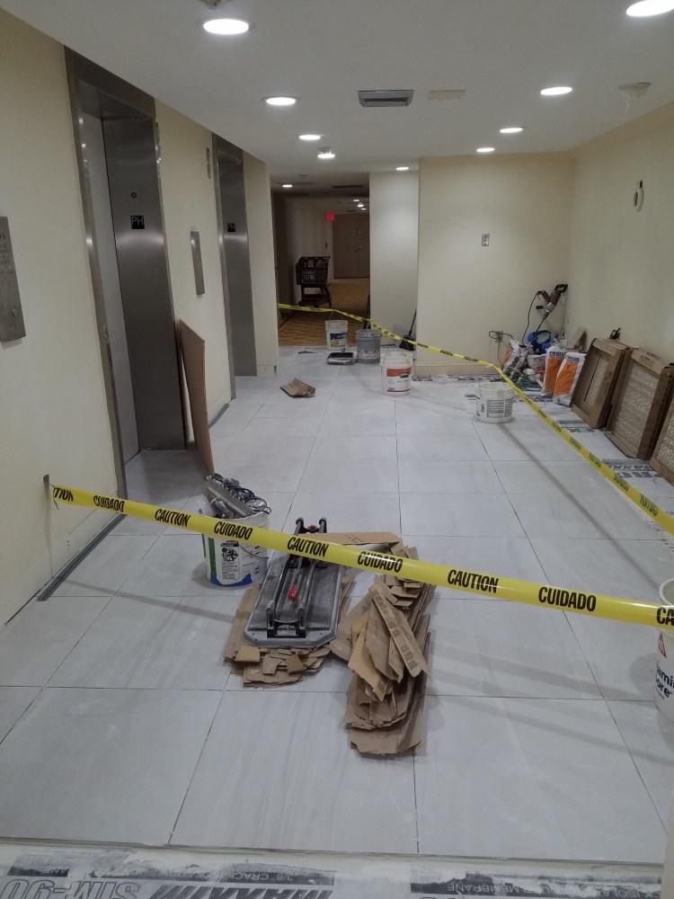 Elevator landing tile