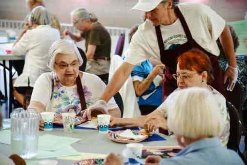 Serving meals at the Elder Cafe