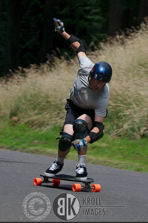 Tuck pumping during the first and only slalom race at this event. I won this head to head event that was located on the soapbox hill. Photo by Kroll Images.