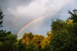 Yesterday afternoon's rumbling thunderstorms over the spine of the Green Mountains provided a lovely rainbow near sunset.