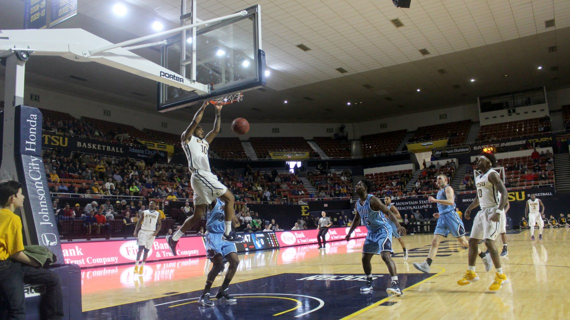 Isaac Banks flushes down the big dunk early in the first half against The Citadel (Photography by Garrett Tumlin)