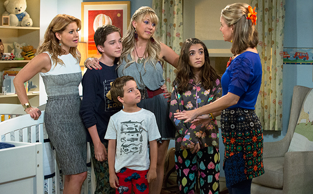 """The characters of """"Full House"""" reunite as adults with children of their own. (Photograph Courtesy of ew.com)"""