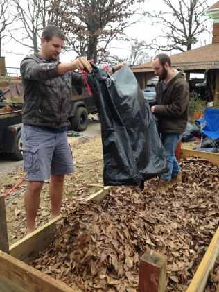 Josh helps build the raised comfrey bed