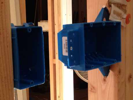 Plastic electrical boxes hung on the wall