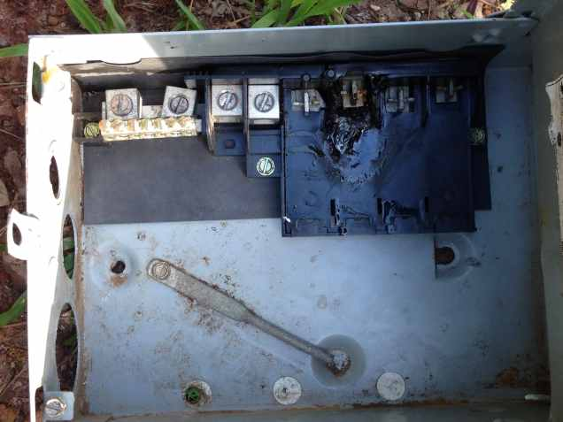 This is the old electrical box that came with the house. It burned up when we attempted to use it.