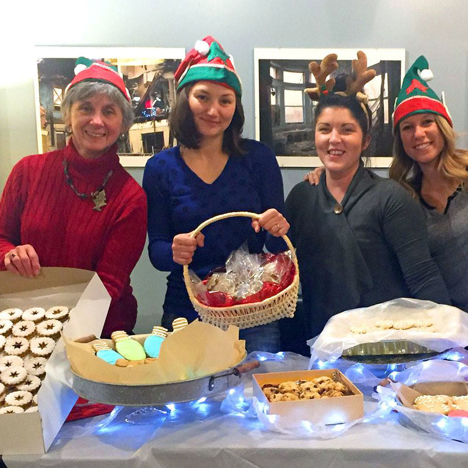 neighbors at holiday cookie exchange at Cafe DeSales