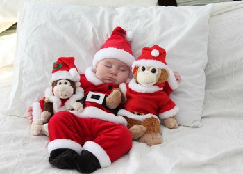 Santa-Baby-Sleeping-With-Christmas-Plush