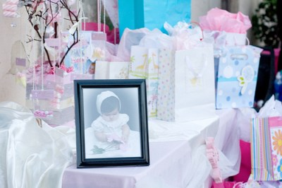 baptism table with favors and girl photo