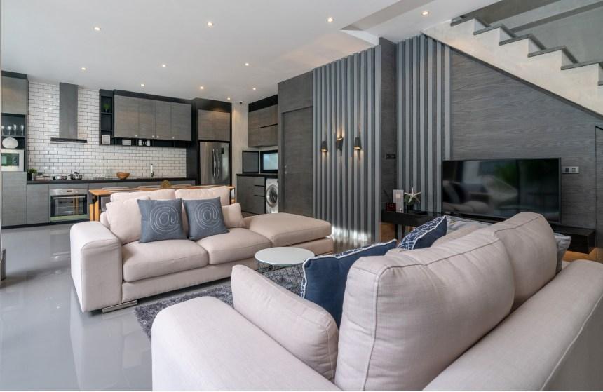 Wohnzimmer modern eingerichtet, aufgeräumt mit Stylischen Möbeln