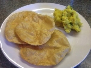 palya, poori with potato side dish