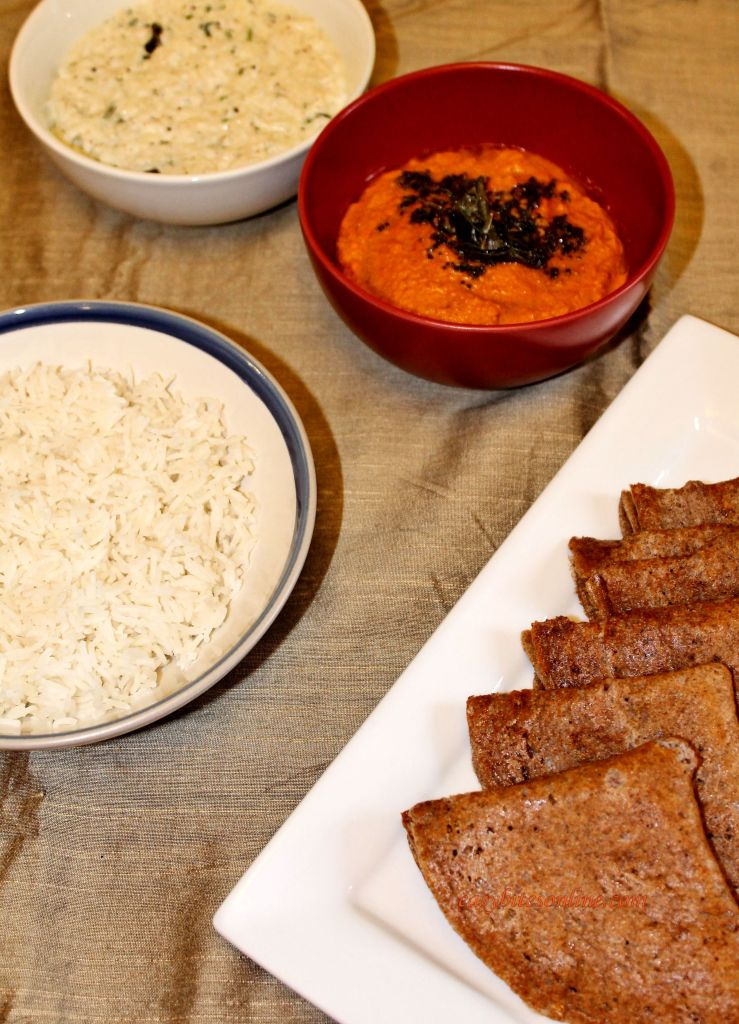 red coconut chutney with ragi dosa, mooli raita and rice