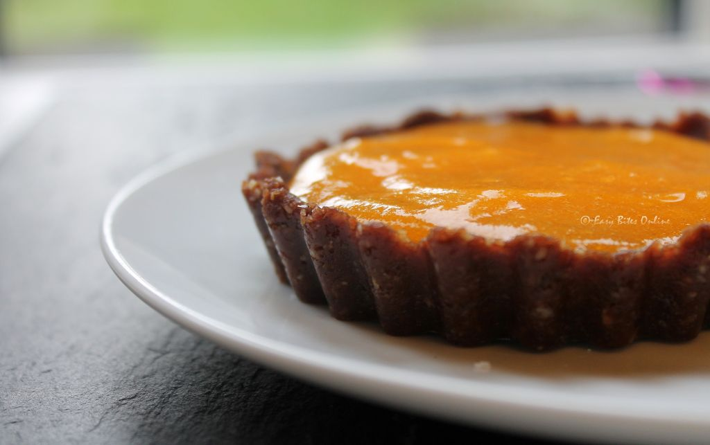 bring out the tart cases, spoon over the puree onto the base