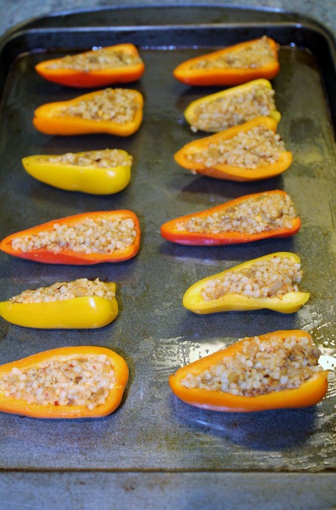 stuff the peppers well and arrange them on a greased baking tray