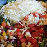 add shredded Indian cottage cheese, chopped baby spinach, chopped tomato, mix