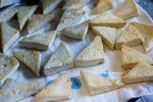 transfer the pan roasted tofu triangles to an absorbant paper towel