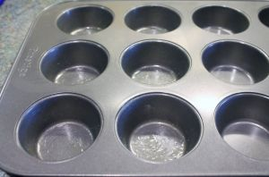 grease the muffin pan with ghee or butter