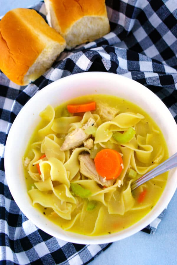 Overhead picture of chicken noodle soup in a bowl with a spoon ready for eating!