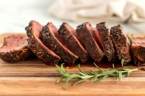 Sliced of sliced roast on a cutting board.