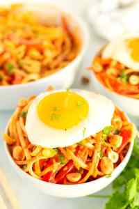 noodles topped with a fried egg.