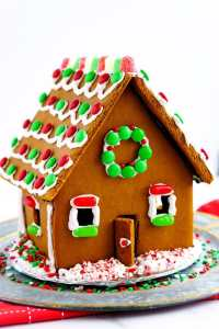 Large gingerbread house decorated with royal icing and candy.