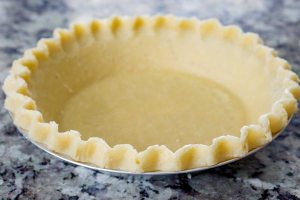 Thaw the pie shell and re-crimp the edges.