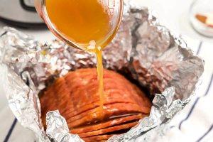 Pour the ham glaze between slices of ham.