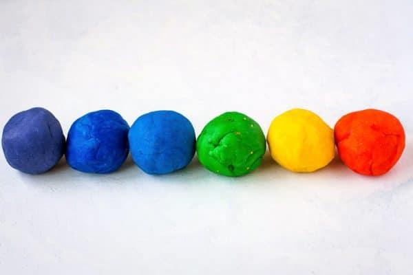Balls of playdough in a row.