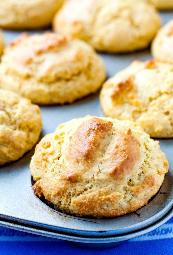 A close up picture of corn muffins in a muffin tin.