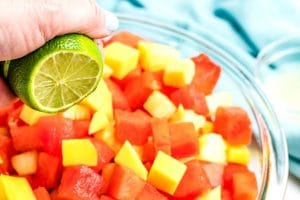 Squeeze fresh lime juice over th fruit and gently toss to combine.
