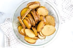 In a large bowl add potatoes, butter, and Ranch seasoning and toss to coat.