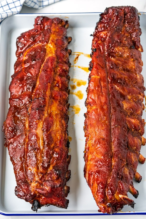 Overhead of 2 racks of spare ribs that just came off of the grill.