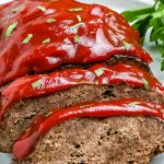 A closeup picture of slices of instant pot meatloaf on a white platter.