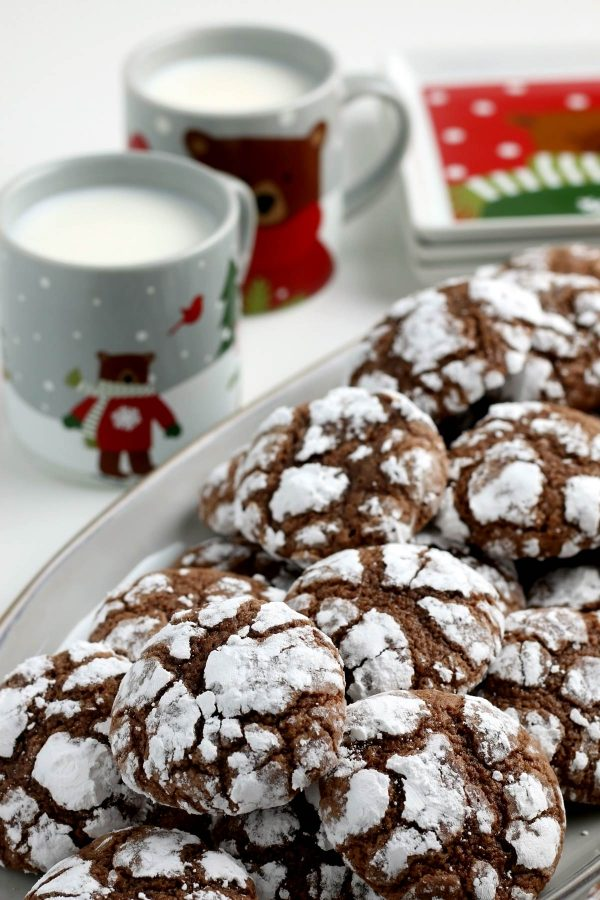 The finished chocolate crinkle cookie recipe on a white platter.