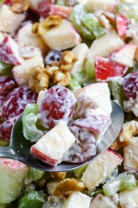 A spoon scooping up some of the Waldorf Salad.