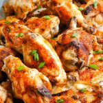 Baked Chicken Wings stacked onto a platter.
